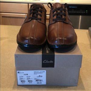 Men's Clark's brown leather dress shoes.